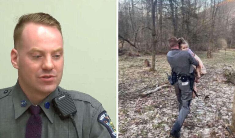 L'agente di polizia trova la bambina scomparsa che si aggrappa a lui e si rifiuta di lasciarlo andare