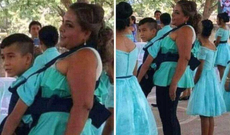 L'insegnante aiuta il suo studente disabile a ballare il valzer di fine anno
